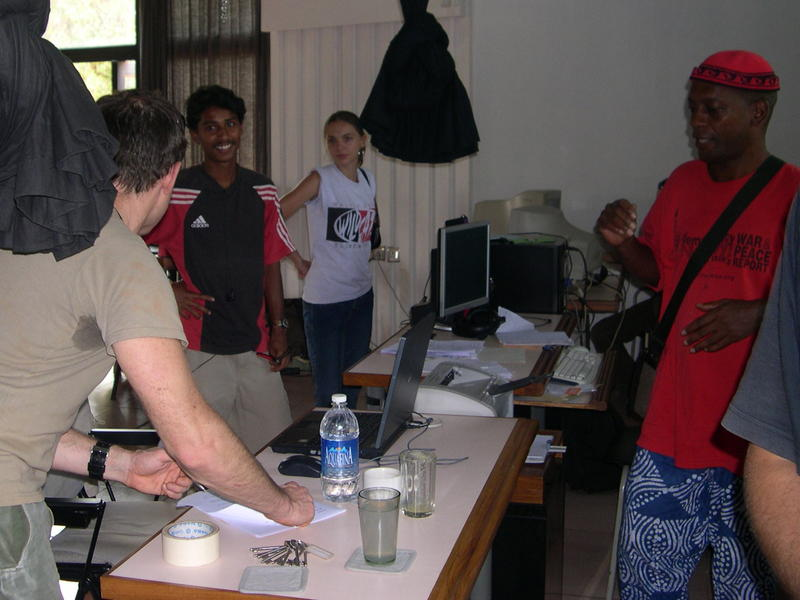 Photographer:Auroville Radio Team  | Anthony Sloan (in red) at the AurovilleRadio organizing the show