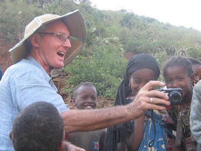 Photographer:Christian Feuillette | Joss with village children
