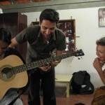 Paolo teaching to play the bass