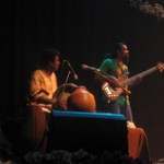 Raasu on Bass Guitar with Souri on drums