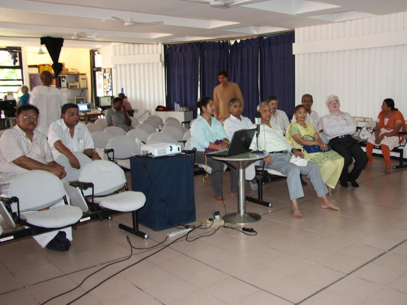 Photographer:Stella | Members of the Sri Aurobindo Society in Auroville Town Hall conference room.