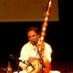 Hemant Chauhan playing his strings instrument kamayacha