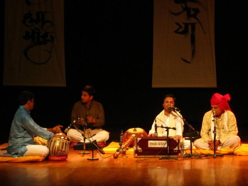 Photographer:Maria   Hemant Chauhan sings and plays harmonium while hosting Prahlad Tipanya on stage