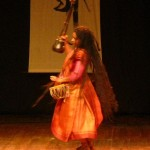 Dancing Parvathy plays with drum, anklets with bells and Ektara, one-stringed
