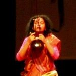 An intense moment of Parvathy's performance with Ektara and Duggi, a small hand-held earthen drum