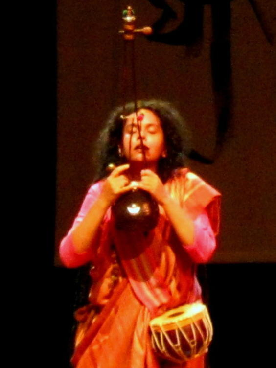Photographer:Maria | An intense moment of Parvathy's performance with Ektara and Duggi, a small hand-held earthen drum