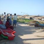 Population of coastal village on the beach
