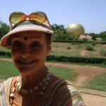 Anandi, radiating sunshine in front of the Matrimandir