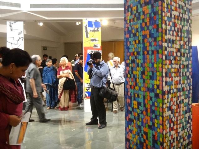 Photographer:Jyothi | Art Exhibition with Aster Patel in the background