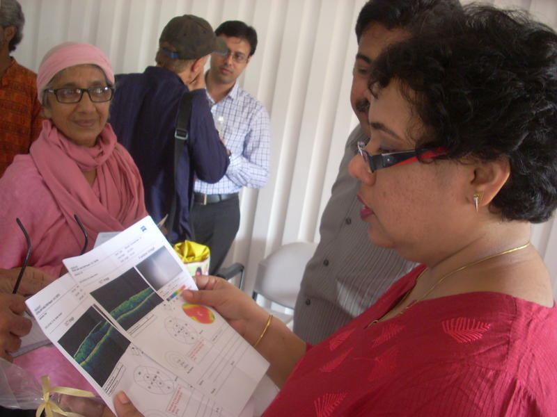 Photographer:Andrea | Dr. Manavi D. Sindal and Dr. Rengaraj Venkatesh examining documentation brough by some patients.