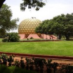 The banyan (as appear today) partially covering the magnificent Matrimandir.