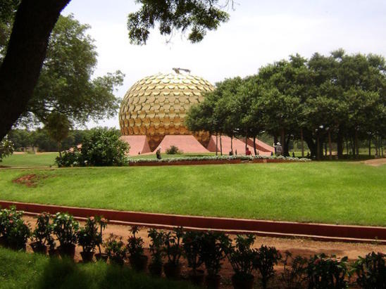 Photographer:Vijay Nambiar | The banyan (as appear today) partially covering the magnificent Matrimandir.