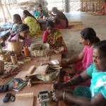 Women recycling paper into crafts at Wellpaper