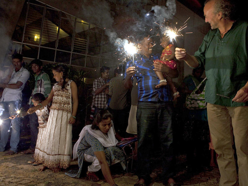 Photographer:Andrea Kunkl | Kids and adults celebrating Diwali.