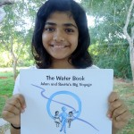 Ahilya with the hard copy of the Water Book.