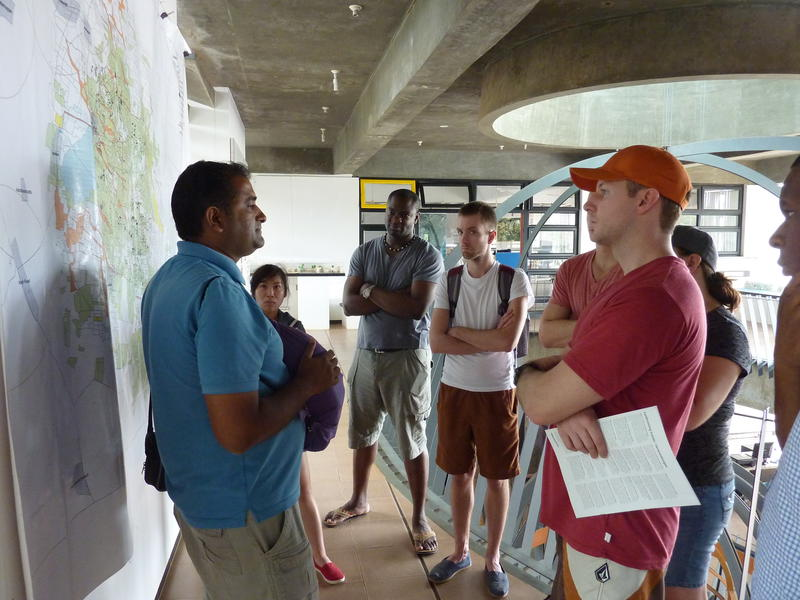 Photographer:Michael Rac | Lalit (left) with students from Queen's University in Kingston, Ontario.