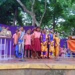 6th grade students singing with Nandida Di. On tabla Debhashis Das.