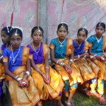 7th grade students waiting to perform Odissi dance on the stage of Udavi school.