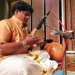 Kardivel and his percussions. On the back the Ghatam (South Indian pot).