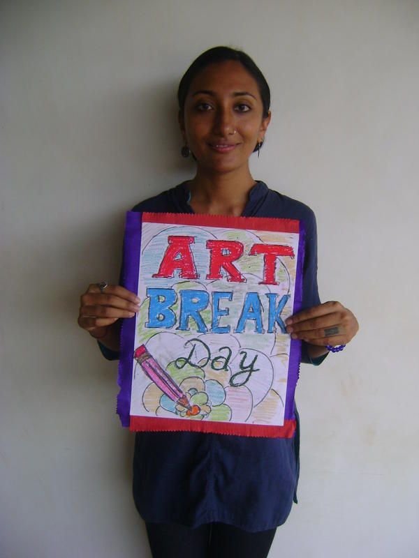 Photographer:Clara | Krupa with poster of one of the volunteers