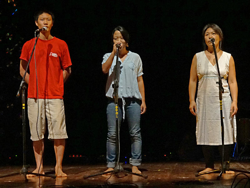 Photographer:Giorgio Molinari | From Right: Amu, Heyong and their mum singing a Korean song.