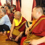 Tibetan monks and Anne Riquier posing a question