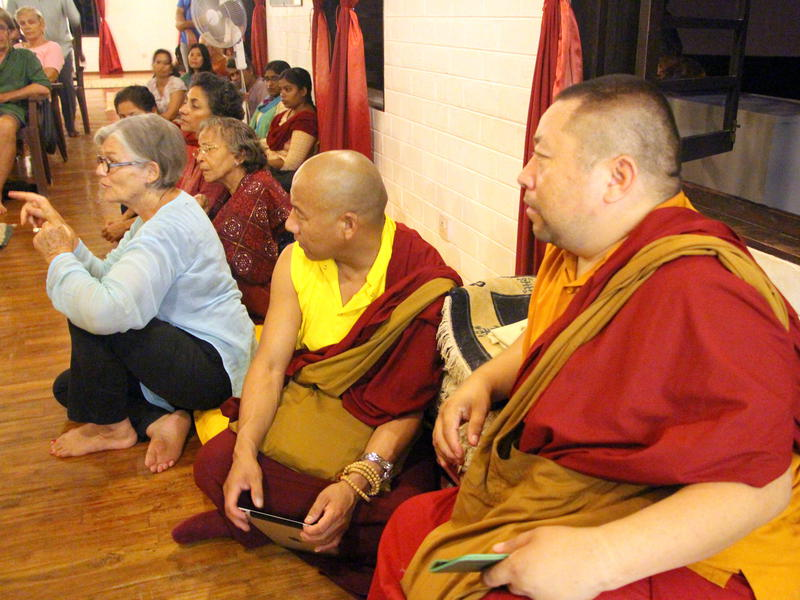 Photographer:Roland | Tibetan monks and Anne Riquier posing a question