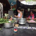 On the right Ishita cutting green chili