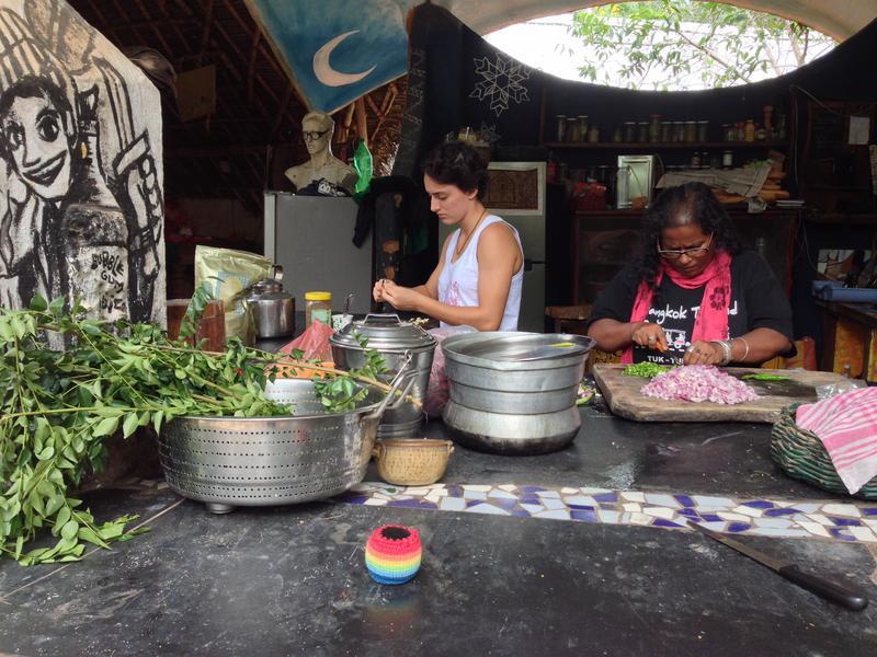 Photographer:Andrea | On the right Ishita cutting green chili