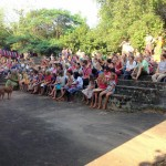 The audience looking at Alice's performance in the small amphitheater