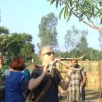 Swedish visitor playing horns