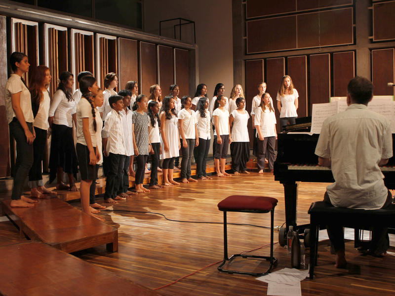 Photographer:Heidrun Holzfeind | On piano Matt accompanying the Auroville Youth Choir