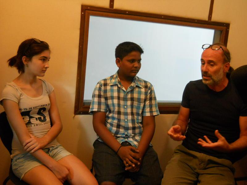 Photographer:Renu | Aloe, Rishi and Andrea explaining at the community service week