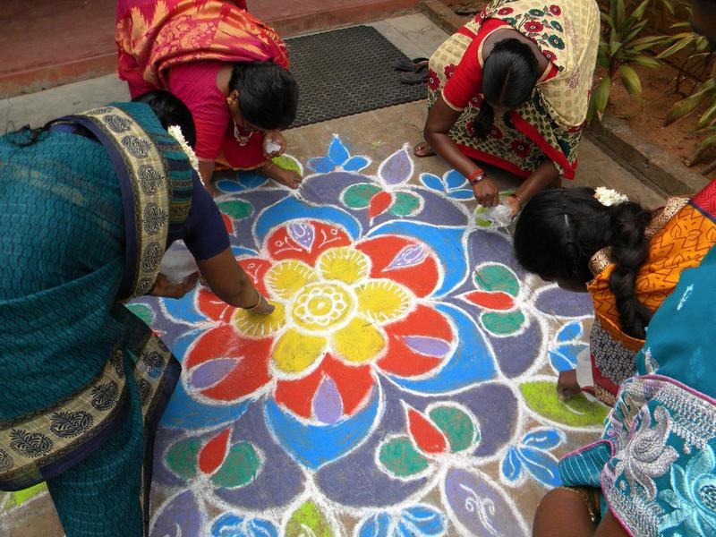 Photographer:Auroville Village Action | Creating a welcome Kolam