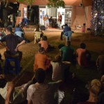 The audience relaxed on the grass for the Emergence Trio