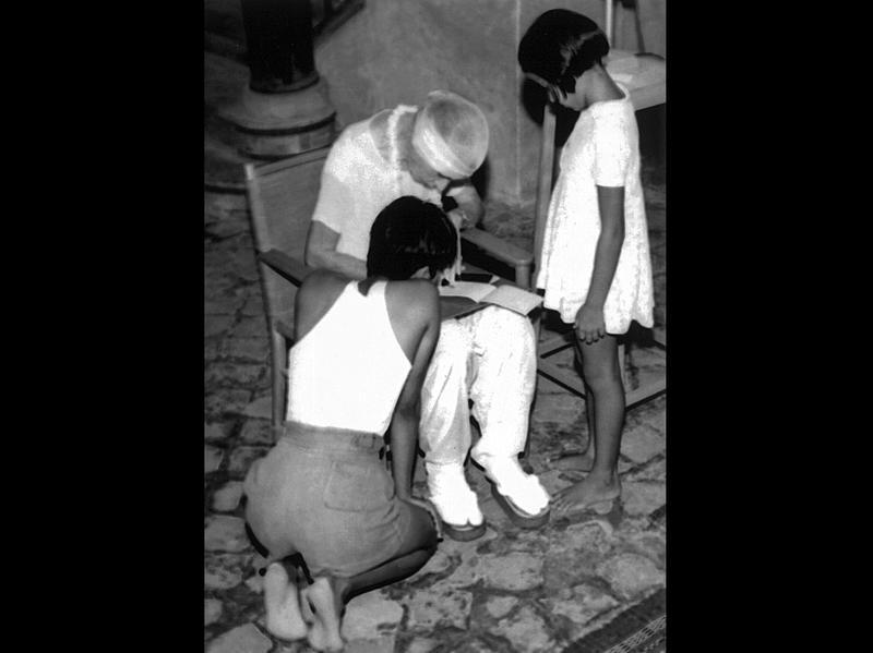 Photographer:Ashram Archives | Mother teaching children