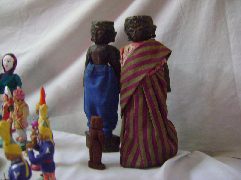 Photographer:Beela | old figurines which were given to the couple at the marriage