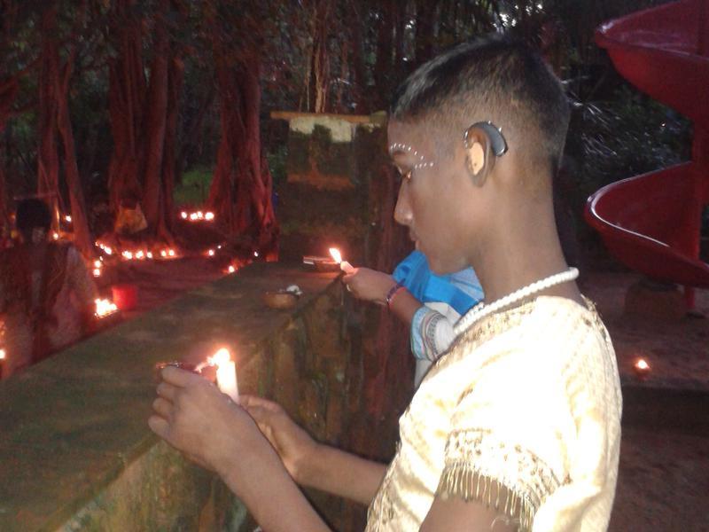 Photographer:Misha | Lighting candles