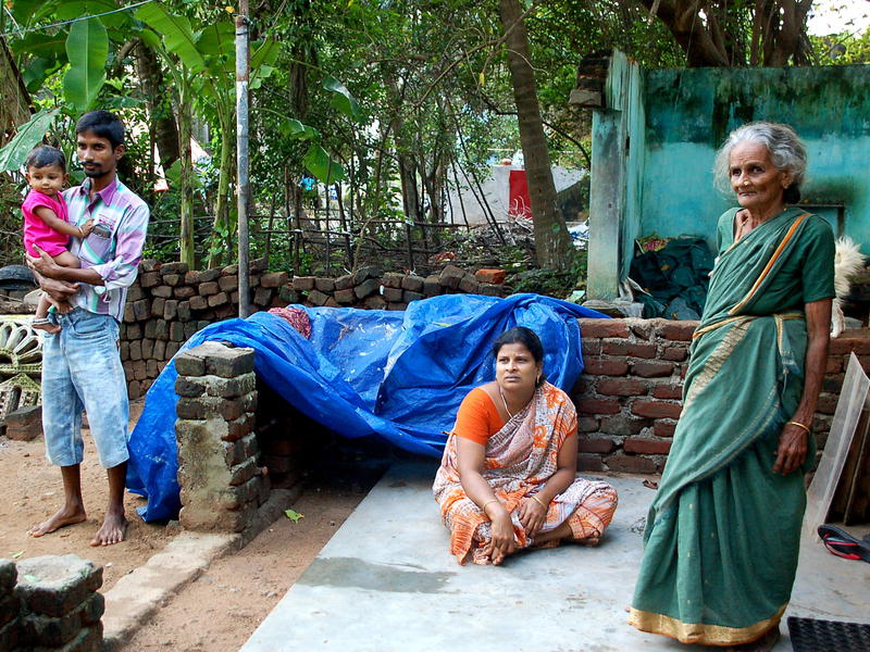 Photographer:Frida   Venkatesh (with his family) is one of the Auroville workers affected by the flood