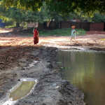 Women are reconstructing a damaged road opposite New Creation