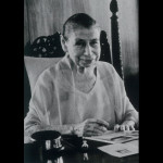 Mother hand-cancelling the new Sri Aurobindo postage stamp