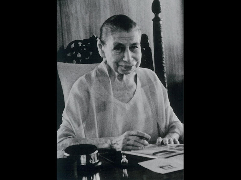 Photographer:Ashram Archives | Mother hand-cancelling the new Sri Aurobindo postage stamp