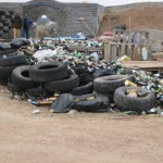 houses made of gargabe - recycling tires, glass, cans....