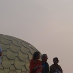 Meditators silhouetted against the Matrimandir