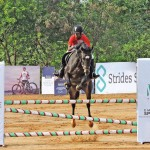 Nandhini riding her horse at the Jumping challenge