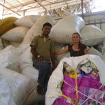 Palani and Kali in front of plastic bags for recycling