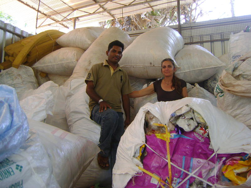 Photographer:Renu | Palani and Kali in front of plastic bags for recycling