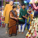 Toine, Meenakshi, teacher liting lamps