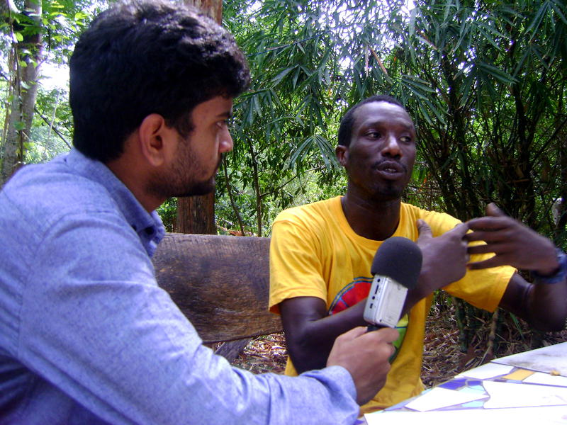 Photographer:David Dinakaran E | Samy, a volunteer at the Youth Centre and initiator of Bantu Ubuntu being interviewed by Stephen