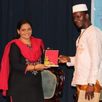Dr. A Shahin Sultana, Head- Dept. of Social Work presents a memento to the African Delegate